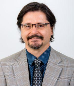 Dr. Bernard J. Luscans