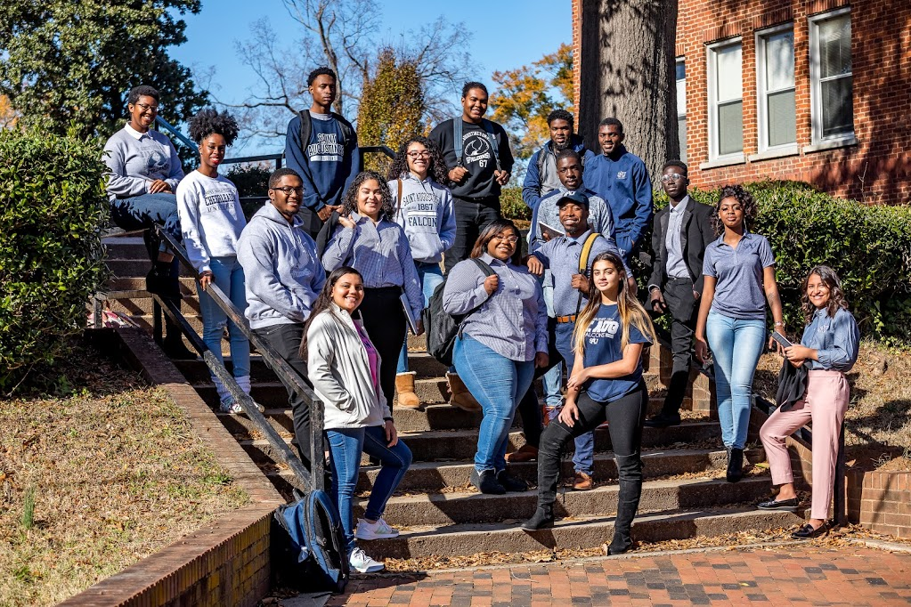 Students posing on steps in SAU apparel