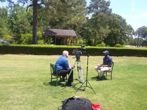 CBS 17 Interviews golf student on lawn